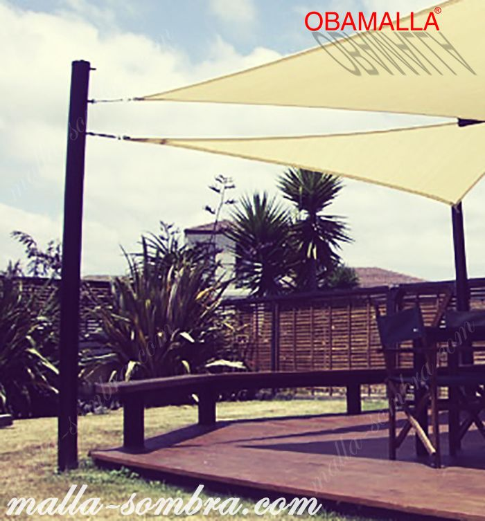 casa sombra obamalla protegiendo el comedor contra los rayos del sol